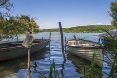 Two old fishing boat. On a lake and a bottle in a pole Royalty Free Stock Photo