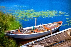 Two old fishing wooden rowboats Stock Photos