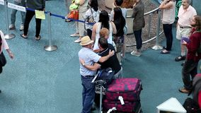 Two old friend hugging together at international arrival lobby stock footage