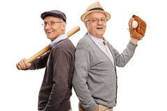 Two old friends and baseball teammates. Studio shot of two old friends and baseball teammates posing together isolated on white background Stock Image