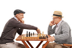 Two old friends playing a game of chess Royalty Free Stock Photo