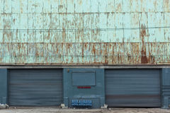 Two old garage doors of a warehouse royalty free stock photos