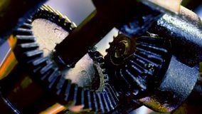 Two old gears rotating in mechanism. Two old gears slowly rotating in undefinied iron mechanism. Black parts on the abstract background stock video