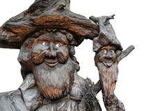 Two old gnomes, guardians of the woods, sculpted in a trunk Royalty Free Stock Photos