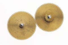 Two old golden cogwheels. Two old gold-coloured little cogwheels are connected Royalty Free Stock Photo