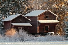 Two old barns in wintry landscape Royalty Free Stock Image