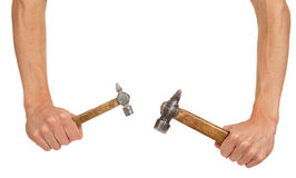 Two old hammers in hands Stock Image