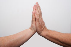 Two old hands pray Stock Photos
