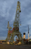 Two old harbour cranes on the pier of Maritime centre of Valamo. Kotka Stock Image