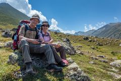 Old hikers with large backpacks resting on mountain Kackarlar. Two old hikers with large backpacks resting on mountain Kackarlar. Kackar Mountains are a mountain stock photos