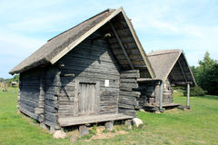 Two old huts. Two old log cabins with reed roof stock photography