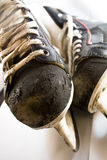 Two old ice hockey skates 2. Well used hockey skates with scars from hits and action Royalty Free Stock Photo