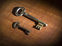 Two old keys. Two obsoletes keys over a wooden table Stock Photo