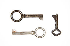 Two old keys to the safe on a white background Royalty Free Stock Images