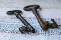 Two old keys on a woven carpet Stock Photography