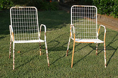 Two Old Lawn Chairs Royalty Free Stock Photo