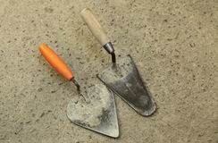 Two Old masonry trowels Royalty Free Stock Photography