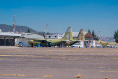 Two old military airplanes parked in the air strip waiting to be repaired Royalty Free Stock Images