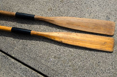 Two old Oars. Two old wooden weathered paddles (oars Stock Images