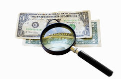 Two old one dollar bills under a magnifying glass Royalty Free Stock Photo