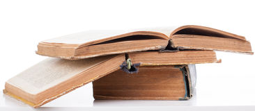 Two old open book lying on a closed book. On white Royalty Free Stock Images