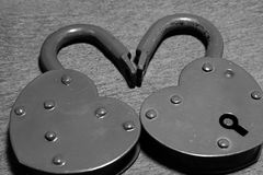 Two old padlocks together black and white photo. Two old padlocks together black and white Stock Image
