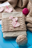 Two old pads in knitted cover with felt hearts Royalty Free Stock Photo