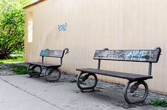 Two old park benches Royalty Free Stock Image