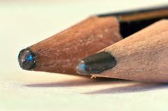 Two old pencils closeup. Two old pencils on paper cloaseup macro royalty free stock images