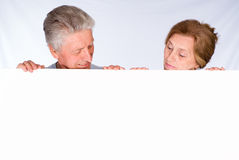 Two old people with board Stock Photos