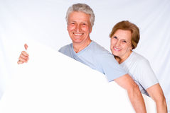 Two old people with board Stock Image