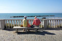 Two old persons watching the sea Stock Images