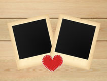Two old photo papers card on wooden table Royalty Free Stock Photos