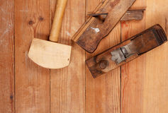 Two old planer and Mallet on a wooden table. Top view . Stock Image