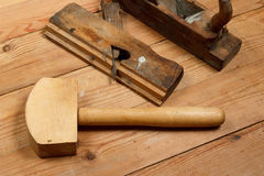 Two old planer and Mallet on a wooden table. Top view . Stock Photos