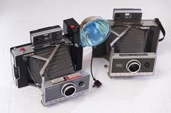 Two old Polaroid cameras Royalty Free Stock Photo