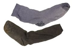 Two old ragged dirty dark  cotton socks. Royalty Free Stock Image