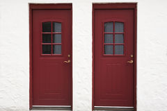 Two old red wooden doors Royalty Free Stock Photo