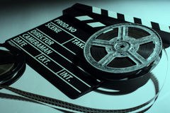 Two old reels of film and cinema clap. Lying on a light table. Toned image Stock Image