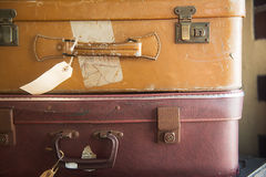Two old retro suitcase with tags Stock Photo