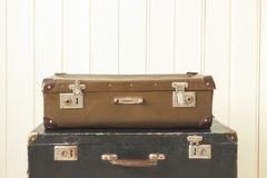Two old retro suitcases White wooden background Vintage tinting stock photo