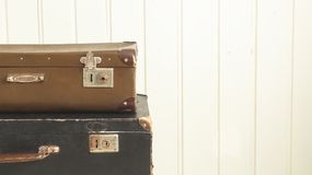 Two old retro suitcases White wooden background Vintage tinting stock photos