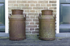 Two old rusted churns Royalty Free Stock Photos