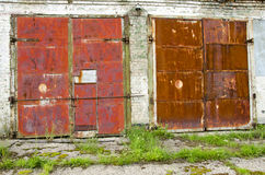 Two old and rusted garage doors Royalty Free Stock Photos