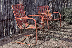 Two old rusty chairs Stock Photo