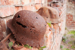 Two old rusty military helmets Royalty Free Stock Photos