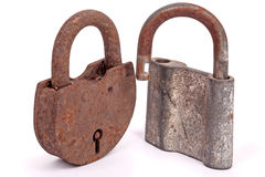 Two old rusty padlocks. Isolated on white background Royalty Free Stock Photos