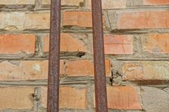 Two old rusty pipes on a brick wall stock photography