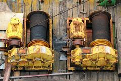 Two old rusty winches with steel rope Royalty Free Stock Photos