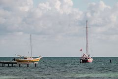 Two old sailboats anchored in the Caribbean sea Stock Photo